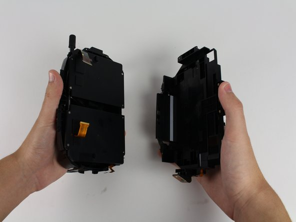 With one hand on the midframe and the other on the eyepiece assembly, pull the two parts away from each other.