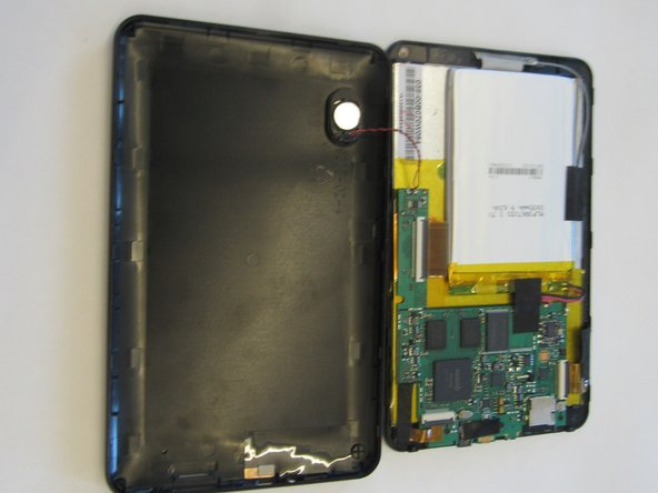 Remove back cover with lever tool, exposing the battery and motherboard.