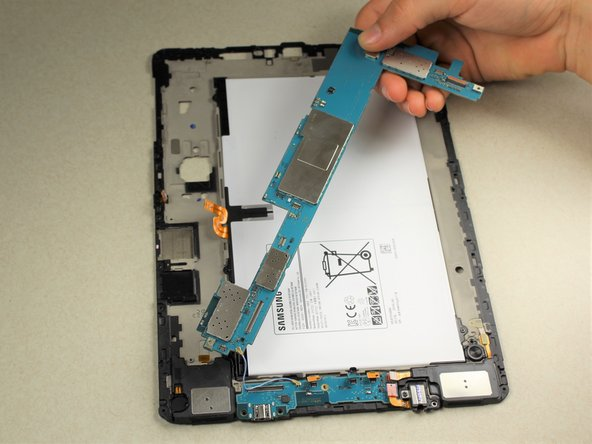 Carefully lift the top portion of the motherboard off of the back panel with your hands.