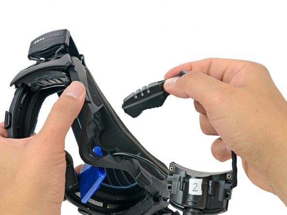 Remove the viewfinder assembly by pulling it through the opening in the top of the frame.