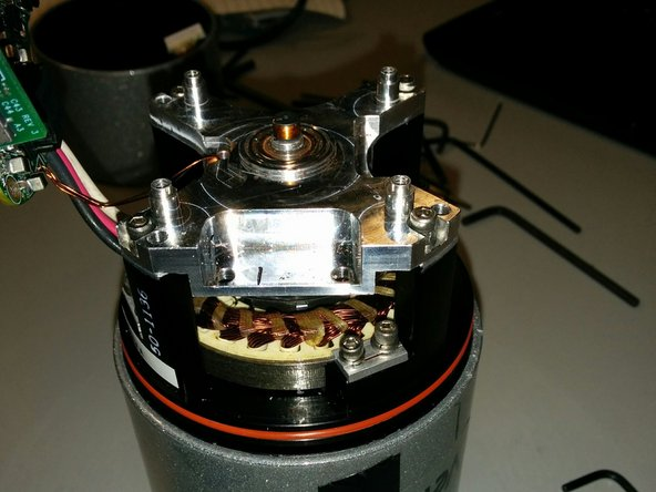 In order to remove the bearing housing, you will need to remove the encoder sensor.