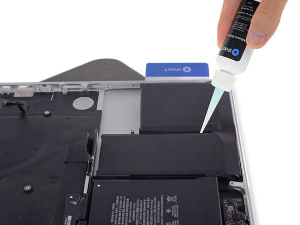 Wait 2-3 minutes for the liquid adhesive remover to penetrate underneath the battery cell before you proceed to the next step.