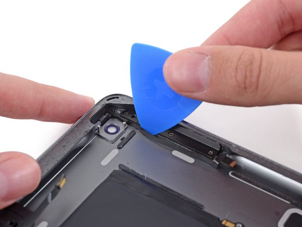 Slide the pick along the length of the cable, stopping at the corner of the case.