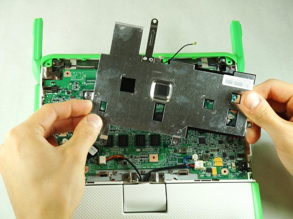 Remove the metal cover by gently lifting it out of the laptop.