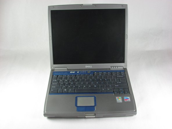 Orient laptop with the keyboard facing upward and the lid open.