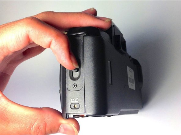 Place the camera on its side so the lens is facing left.