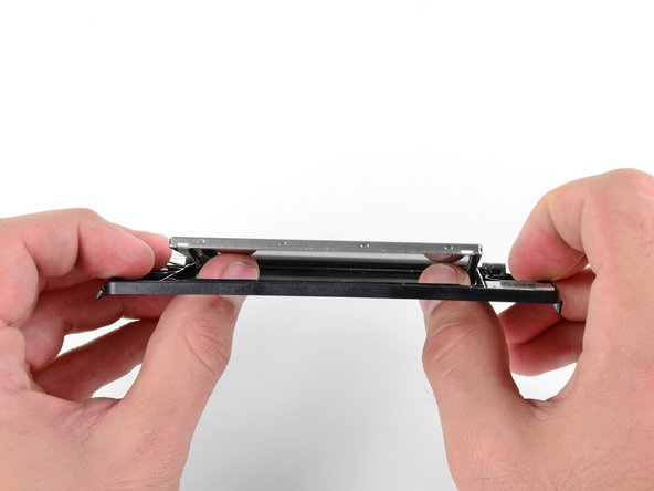 Image 1/2: Use your thumbs to push the upper LCD from the front out of the upper display bezel.