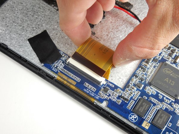 Remove all three ZIF cables connected to the motherboard (the blue, angled piece) by lifting the gray flap with your finger or a plastic spudger and gently removing the cable.