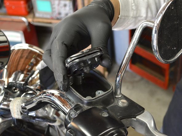 Carefully remove the cover of the master reservoir, making sure that you do not spill any of the  brake fluid.