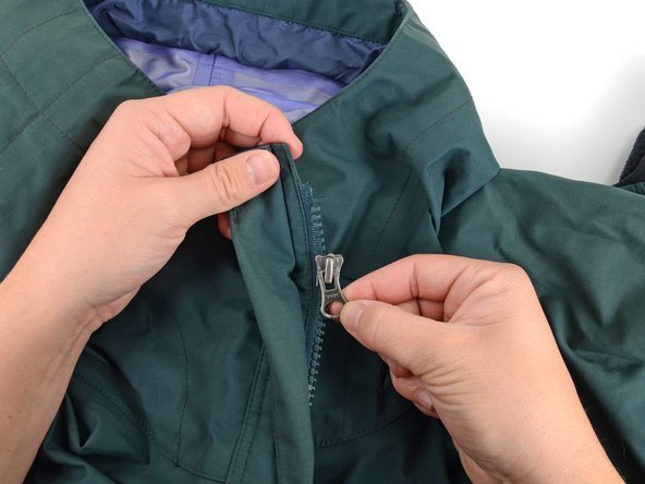 Image 3/3: Make sure the zipper slider is oriented right-side up when you slide it back onto the zipper.
