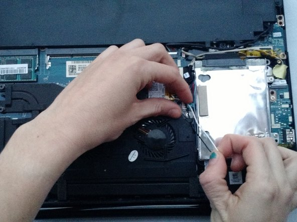 Image 2/3: Carefully unhook each grouping from the small black tabs on the fan