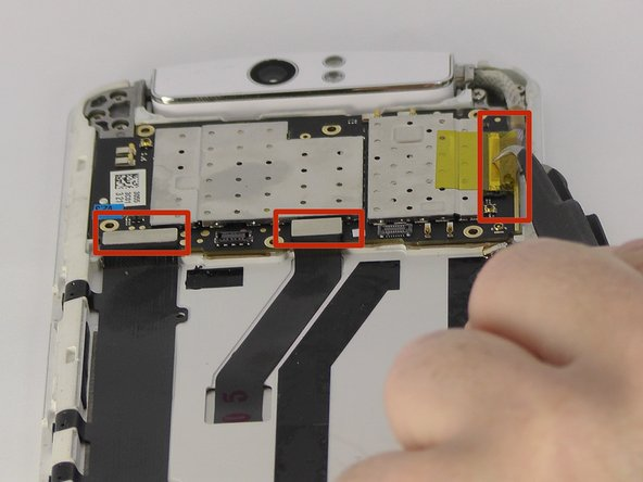 Use tweezers or fingers to remove the three connector tabs.