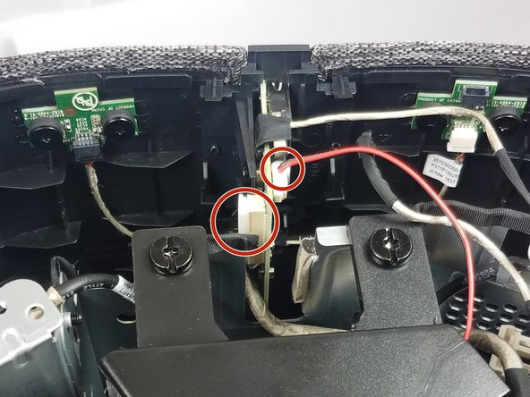 Remove the two cables connecting the motherboard to the front I/O panel.