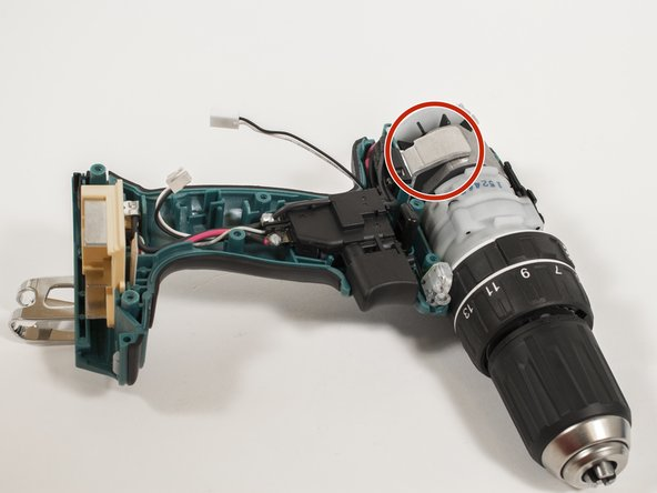 Pull the silver metal clip on the motor away from the drill.