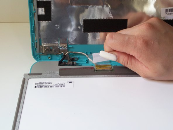 Peel off the barcode sticker to reveal the screen connector plug.