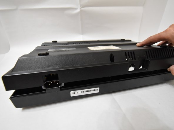 Carefully remove the bottom of the ColecoVision out of the top.