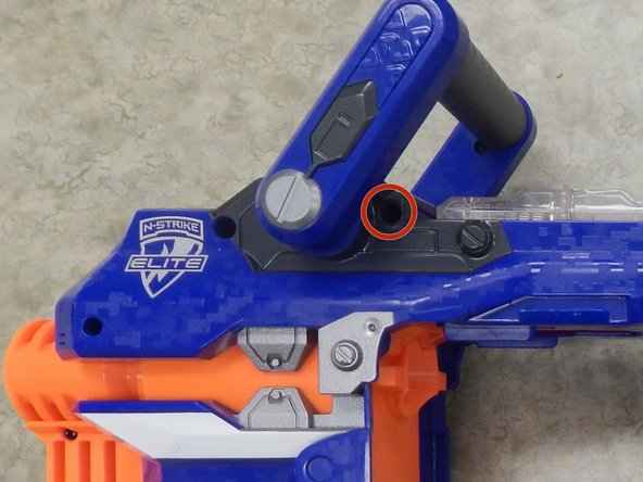 Remove the single 14.0 mm Phillips screw holding together the handle and the Nerf Gun.