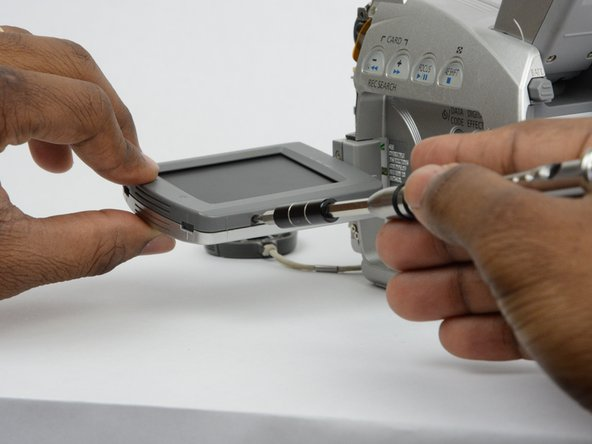 Locate and remove the 2.7 mm screw on the bottom of the LCD monitor.
