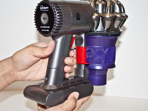 Pull the base of the vacuum down, away from the main body