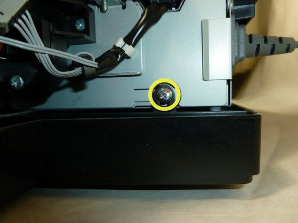 Using the #2 Phillips screwdriver, remove the last three 10mm screws securing the printer mechanism.