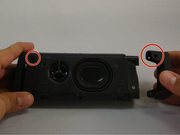 Image 1/3: Pull on the speaker covers, thus removing them