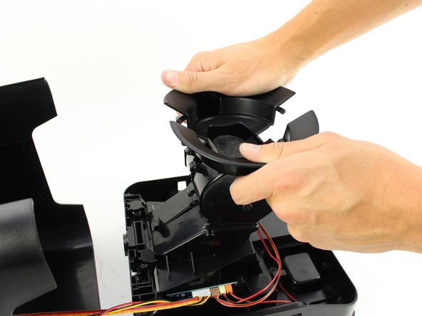 Pull apart the two sides of the central pillar at the top by using both hands.