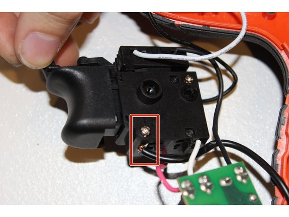 Image 2/3: Use your PH000 screw driver with bit J0. After the screw is released gently pull out the black wire.