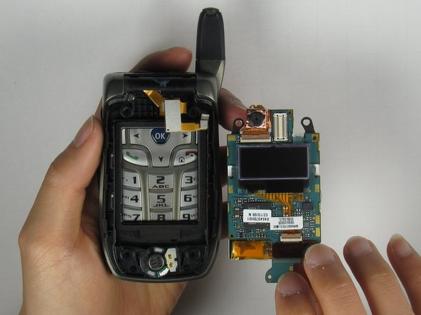 Remove the LCD board from the phone by grabbing the bottom side of the LCD board.