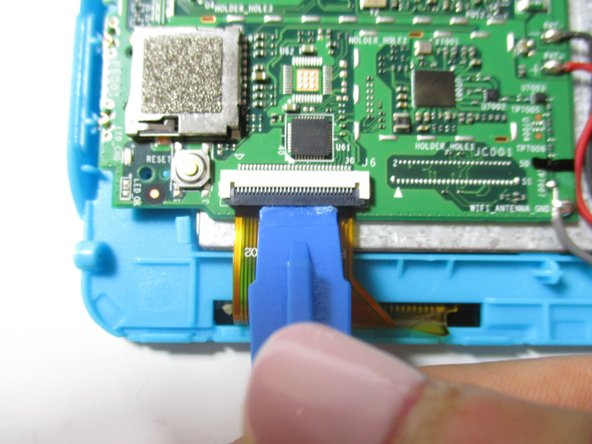 Remove the orange data display ribbon wire to the left of the battery by prying open the ZIF connector with the plastic opening tool.