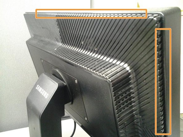 Turn monitor face down on cloth to avoid scratches