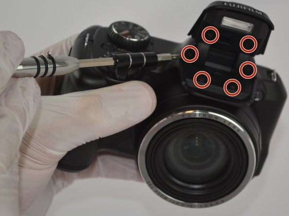 Image 1/2: Remove the plastic cover from the flash lid by gentle pulling them apart or using the plastic opening tool.