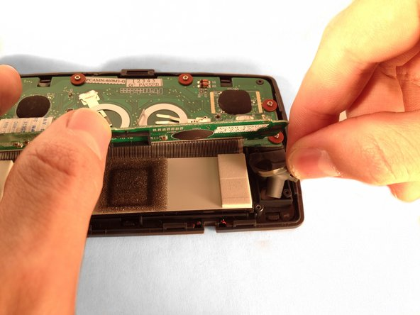 Gently lift the upper circuit board to locate the up/down keypad and remove it.