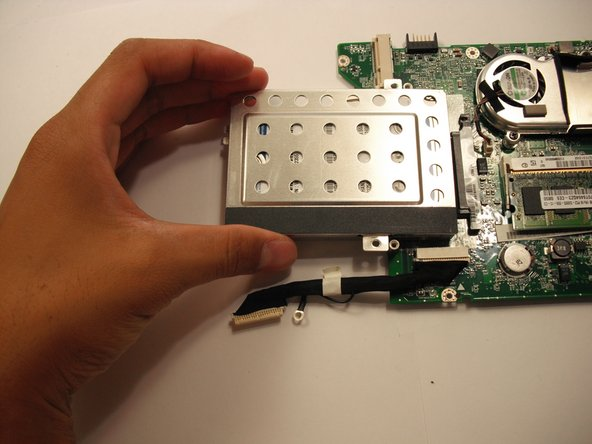 Pull the hard drive straight out from the motherboard.