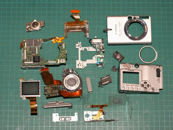 Here are all the components of my disassembled Canon PowerShot S500, excluding the battery and screws.