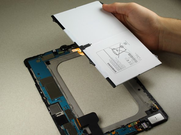 Gently lift the battery up from one corner using your hands to remove it from the rest of the central panel.