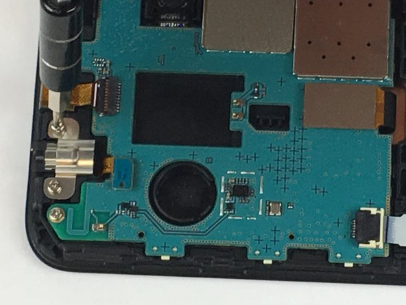 Image 3/3: Remove the four Phillips head screws attaching the motherboard to the plastic case using a P000 screwdriver.