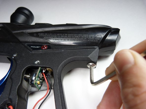 "Remove the front and rear 1"" screws on the gun's grip frame using a 3/32"" Allen Wrench."