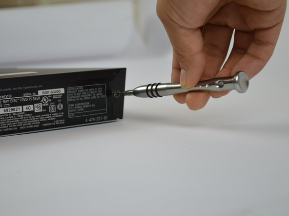 Use a #1 Phillips screwdriver to remove the three screws located in the back of the device.
