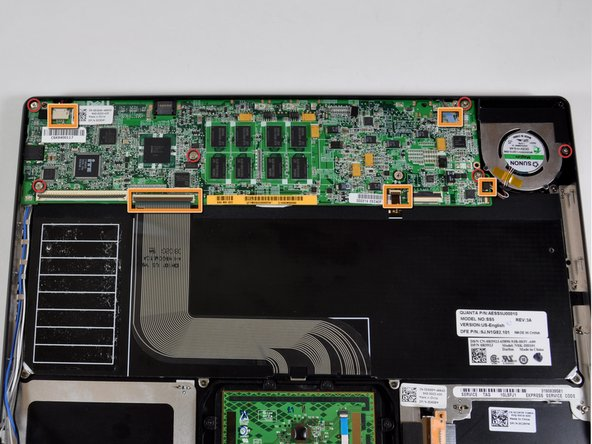 Image 1/2: Six Phillips screws hold the motherboard and its attached heat sink and fan in place.
