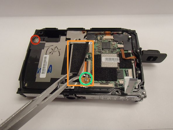Image 2/3: Remove PH00 screw (originally hidden beneath tape)