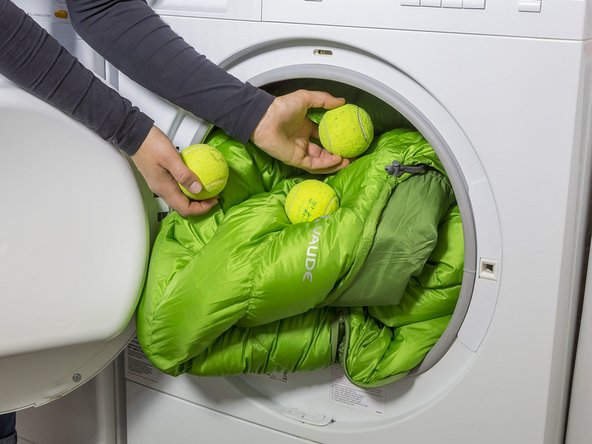 Image 1/2: If you don't have a dryer, you can hang your sleeping bag on a drying rack in the sun. Turn it often and shake it out while it's drying to distribute the loft evenly. Repeat this procedure until the sleeping bag is dry.