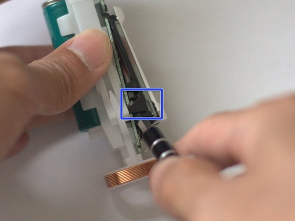 Pull the plastic clip and lift the LCD screen a little bit on both side so you can free the LCD screen from the bottom