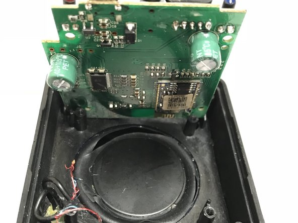 Remove bus wire from the speaker's motherboard and lift the motherboard out of the speaker.