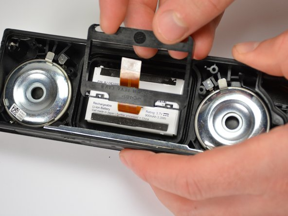 Once all of the tabs have been undone, the inner housing will pop out and the battery will be accessible.