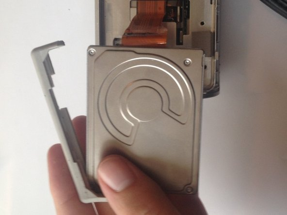 Remove the rubber mounting brackets by pulling them off the hard drive.