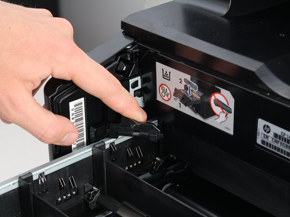 Push it forwards into the printer and maintain pressure on the lock.