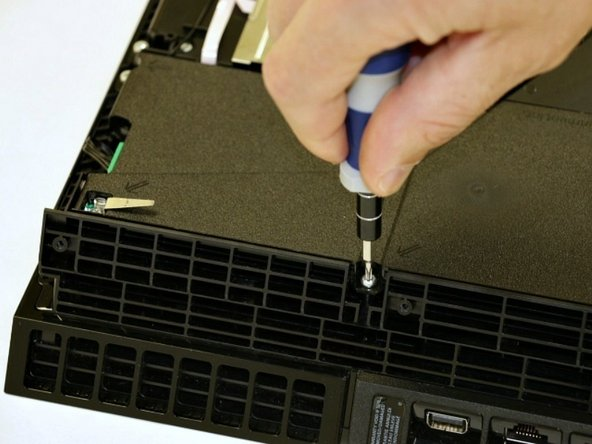 Remove the five screws that secure the power supply. There are two PH1 and three T9 torx security screws.