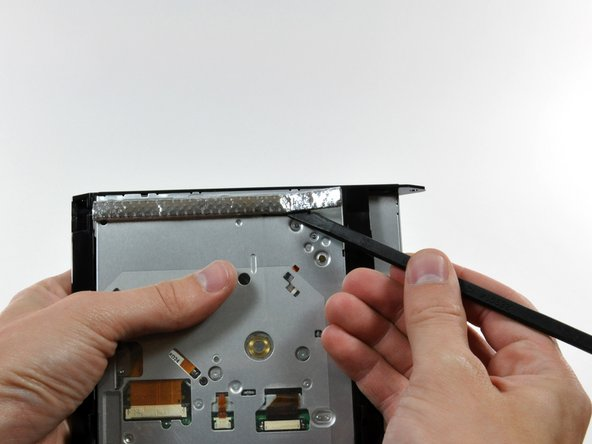 Use the flat end of a spudger to remove the EMI gasket from the underside of the optical drive.
