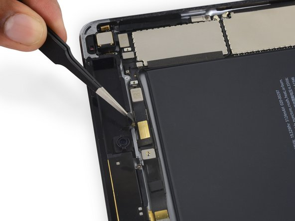 Peel up the tape holding down the front facing camera's ribbon cable.