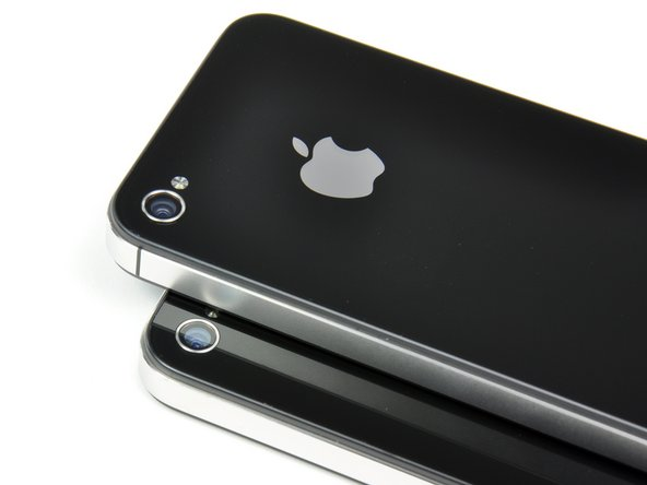 Image 1/2: There are a few external differences, reflecting the different antenna design of the new CDMA iPhone.